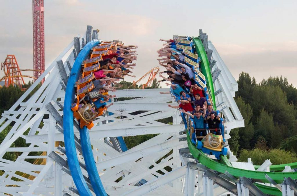 Roller Coaster with riders on two different tracks